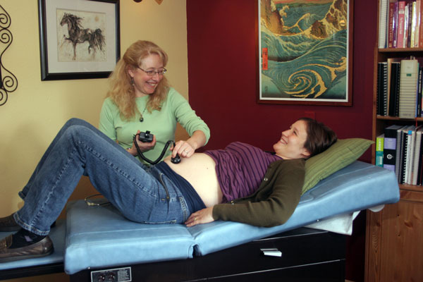 Dr Zieman ND LM examines expectant mother